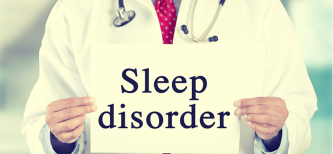 Closeup doctor hands holding white card sign with sleep disorder text message
